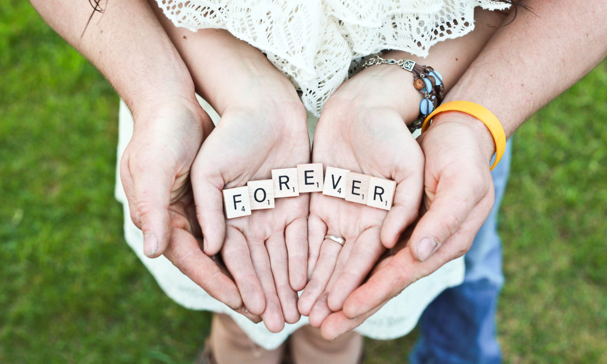 forever in scrabble letters in hands