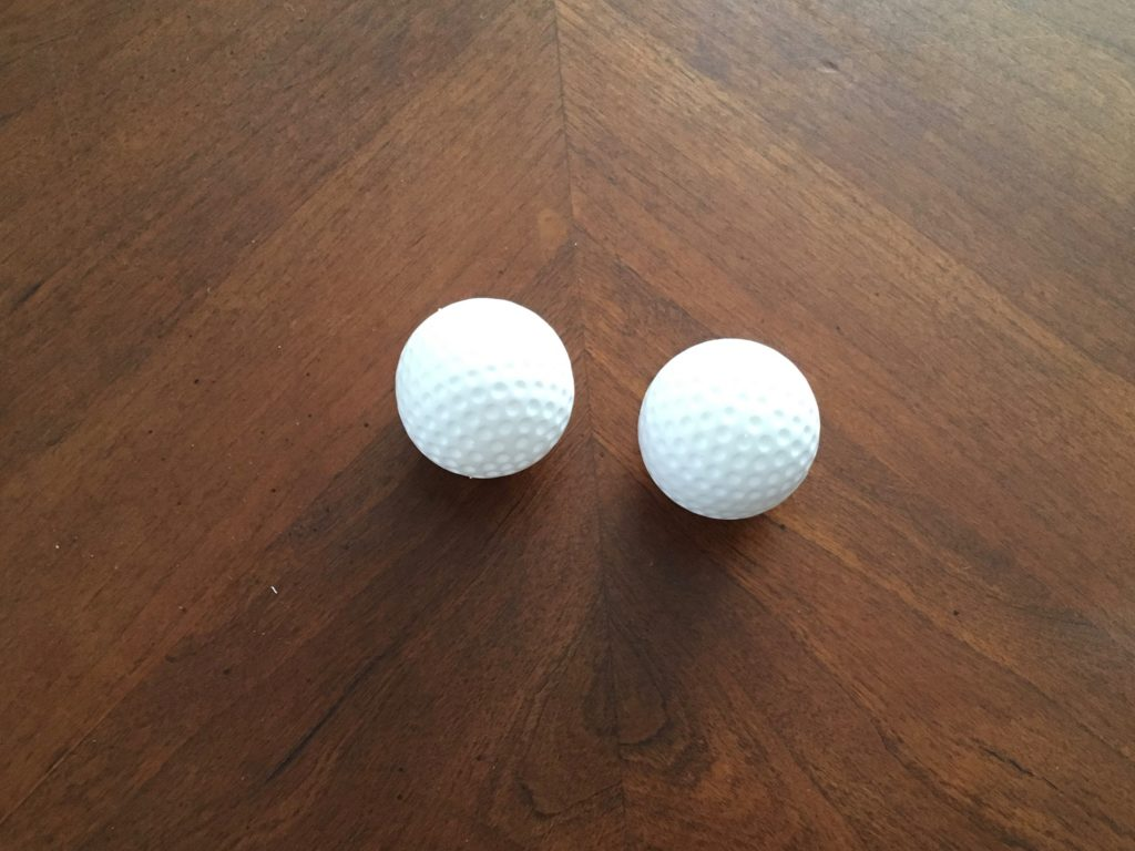 two toy plastic balls for vasetomy scrotal model. these look like golf balls but are actually smaller and much less expensive.
